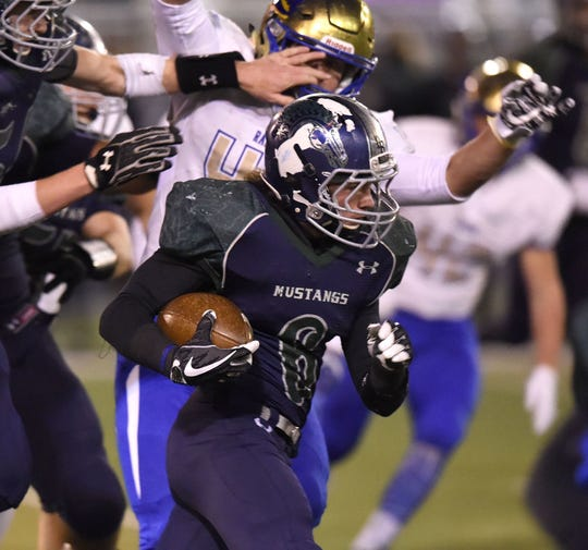 Damonte Ranch's Ryon Hurley carries the ball against Reed in a playoff game at Damonte Ranch.