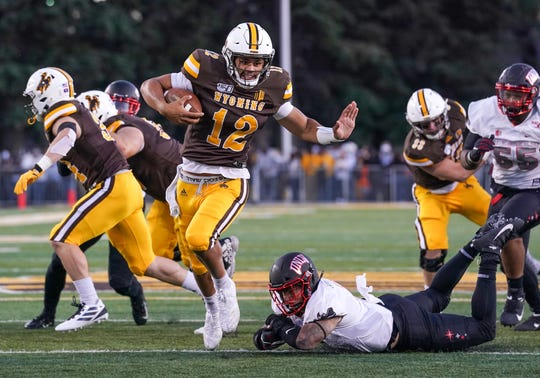 Wyoming quarterback Sean Chambers runs for a touchdown against UNLV at War Memorial Stadium.