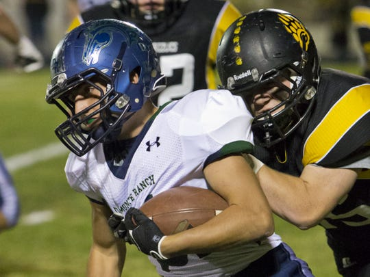 Damonte Ranch's  Grant Cooper is tackled by Galen's Luke Morse during their game Oct. 24, 2013. at Galena.