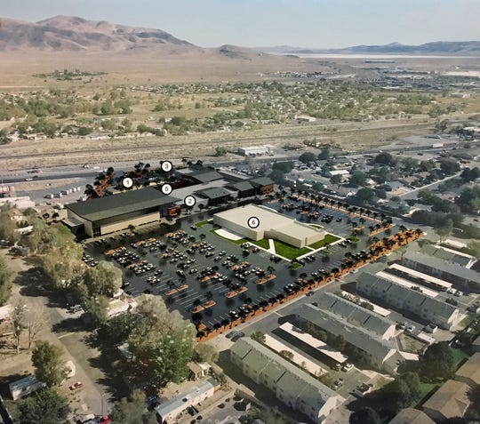 An aerial rendering of the proposed community center, with the new senior center located in the foreground.