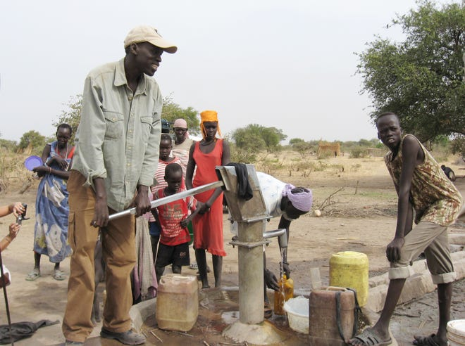 Salva Dut at water pump. Photo supplied by Water for South Sudan