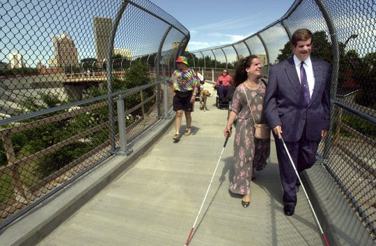 From 2000: Lisa Hoffman and Todd Eggert take their first walk on a pedestrian bridge over I-490 near Clinton Ave. in Rochester. The walkway replaced an underpass that Hoffman and Eggert help convince the state was needed.