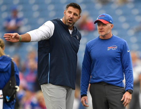 Tennessee Titans head coach Mike Vrabel, left, talks to Buffalo Bills head coach Sean McDermott prior to last season's game at New Era Field. Both coaches have mobile QBs who keep them in state of high anxiety.