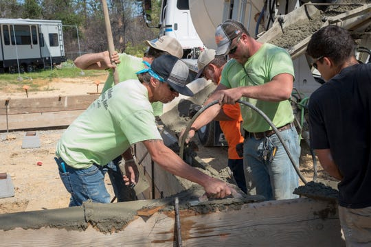 Crews with Mike Boban Construction pour concrete on Friday, Sept. 27, 2019, for the first Carr Fire rebuild done by a group of contractors and volunteers. This is home is on Whispering Pines Drive in Shasta.