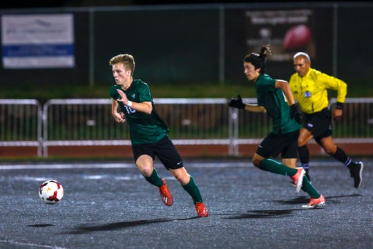 Titans midfielder Andres V. Labate (10) drives the ball down the field during the West Salem Titans and McNary Celtics soccer game at West Salem High School, Oct. 1, 2019.