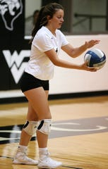 Water Valley High School's Carlee Sims gets ready to serve against Miles during a District 7-2A volleyball match at Water Valley on Tuesday, Oct. 1, 2019.