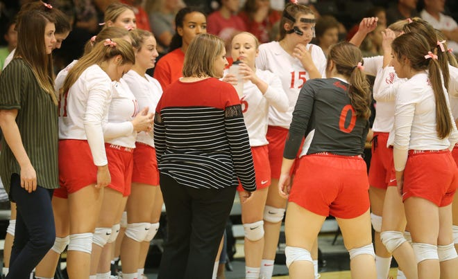 Miles High School head coach Courtney Lange talks to the Lady Bulldogs during a District 7-2A volleyball match at Water Valley on Tuesday, Oct. 1, 2019.
