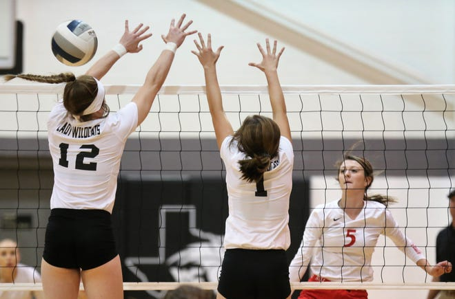 Water Valley High School's Kalysta Minton-Holland (left) and Kylie Bradley try to block a shot by Miles' Tycie Lange during a District 7-2A volleyball match at Water Valley on Tuesday, Oct. 1, 2019.