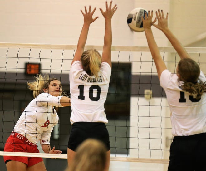 Miles High School's Halle Hudson tries to make a shot between Water Valley's Chesney Baker (10) and Kendra Hoover during a District 7-2A volleyball match at Water Valley on Tuesday, Oct. 1, 2019.