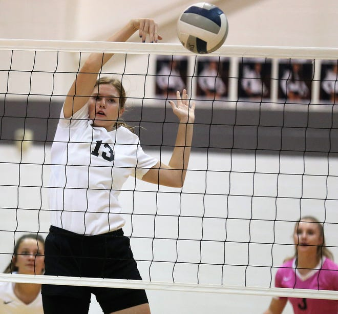Water Valley High School's Kendra Hoover knocks down a shot against Miles during a District 7-2A volleyball match at Water Valley on Tuesday, Oct. 1, 2019.