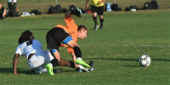 Parkside goalie Gavin Gray goes for the save against Crisfield on Tuesday, Oct. 1, 2019.