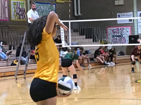 Captain Shreve's Alexis Martinez prepares to serve against Natchitoches Central Tuesday night at Shreve.