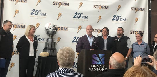 Todd Tryon (center) speaks to the media after announcing the sale of the Sioux Falls Storm to (from left) Jason Headlee, Valerie Headlee, Amber Garry, Patrick Garry, Stephanie Richter and David Richter.