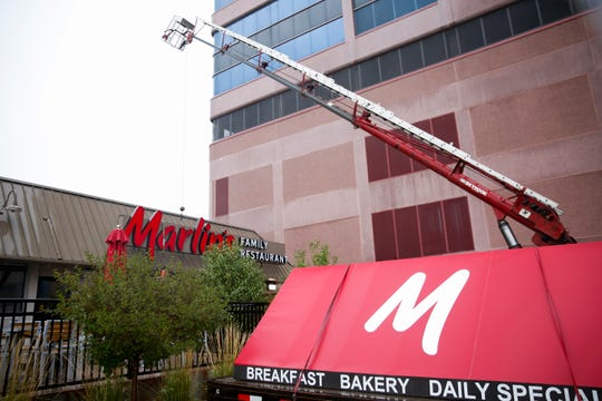 The Marlin's Family Restaurant sign is removed at their 108 S. Minnesota Ave. location on Wednesday, Oct. 2, 2019.