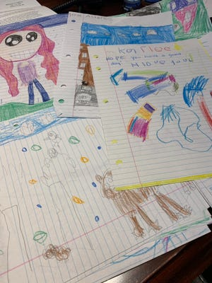 A collection of pictures from a second-grade class in West Virginia, sent to Sioux Falls as a care package.