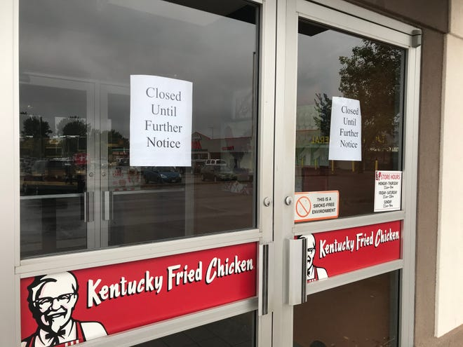 "A sign posted on the KFC location at 300 S. Kiwanis says the fast food restaurant is ""closed until further notice."""