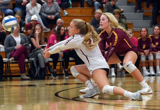 Roosevelt players Tatum Kooima and Tatum Wilson go for the ball during a match against Washington High School on Tuesday, October 1, in Sioux Falls.