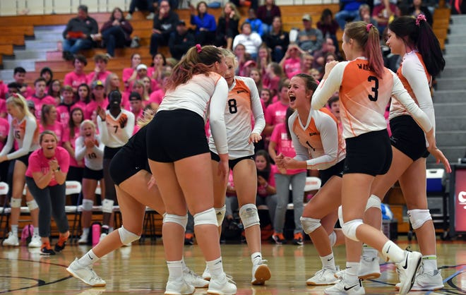 Washington High School volleyball players celebrate a hard-earned point during a match against Roosevelt on Tuesday, October 1, in Sioux Falls.