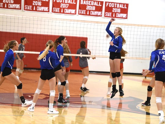 Fort Defiance players cheer a point Tuesday in a match at Riverheads.