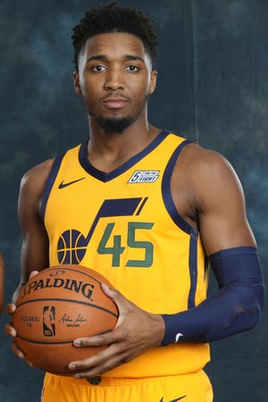 Utah Jazz guard Donovan Mitchell poses for a photograph during the NBA basketball team's media day Monday, Sept. 30, 2019, in Salt Lake City.