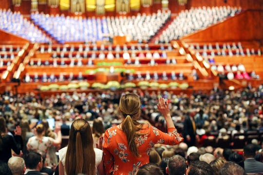 """FILE - In this March 31, 2018, file photo, people participate in a solemn assembly during the start of a twice-annual conference of The Church of Jesus Christ of Latter-day Saints, in Salt Lake City. The Church of Jesus Christ of Latter-day Saints will allow women to be official """"witnesses"""" at two key ceremonies where they were previously only allowed to observe in the latest small step toward breaking down rigid gender roles in the religion. Church President Russell M. Nelson said in a news release Wednesday, Oct. 2, 2019, that the policy change allows women to serve as witnesses at baptisms for the living and dead and at a ceremony inside church temples for married couples called a """"sealing,"""" which the faith believes unites the couple for eternity. (AP Photo/Rick Bowmer, File)"""