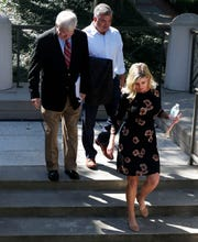 Melissa Oglesby, president of construction management firm KaiserKane, and Trey Gardner, former vice president of the firm, leave the federal courthouse in Tallahassee on Wednesday, Oct. 2, 2019, with their attorney Jimmy Judkins.