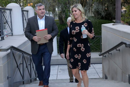 Melissa Oglesby, president of construction management firm KaiserKane, and Trey Gardner, former vice president of the firm, enter the federal courthouse in Tallahassee on Wednesday, Oct. 2, 2019, with their attorney Jimmy Judkins.