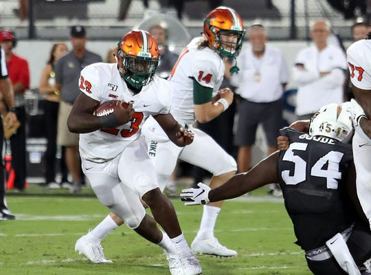 FAMU freshman running back Terrell Jennings looks to gain ground versus UCF.