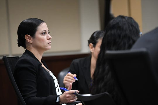 Attorney Tara Kawass, representing Katherine Magbanua, listens as Saam Zangeneh, attorney for Sigfredo Garcia, cross examines key key witness Luis Rivera during Magbanua and Garcia's trial for the 2014 murder of Florida State University law professor Dan Markel at the Leon County Courthouse Wednesday, Oct. 2, 2019.