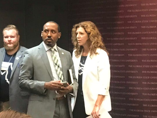 Tallahassee Rep. Ramon Alexander and Leon County Commissioner Kristen Dozier confer before speaking at the Hemp Summit