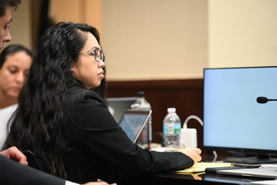 Katherine Magbanua listens as Saam Zangeneh, attorney for Sigfredo Garcia, cross examines key witness Luis Rivera during Magbanua and Garcia's trial for the 2014 murder of Florida State University law professor Dan Markel at the Leon County Courthouse Wednesday, Oct. 2, 2019.