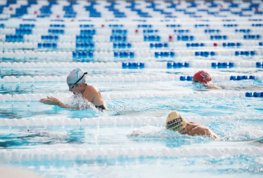 Jensen Beach's Emma Rooney (left) takes first place in the girls 100 breaststroke against Martin County, South Fork and The Pine School during the high school swimming Martin County High School County Championships on Tuesday, Oct. 1, 2019, at Sailfish Splash in Stuart.