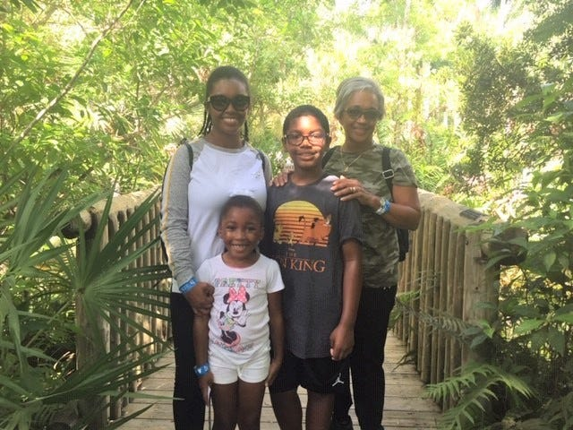 The Jones family from Port St. Lucie enjoys the beautiful weather during Community Appreciation Day at McKee Botanical Garden on Sept. 21, 2019.