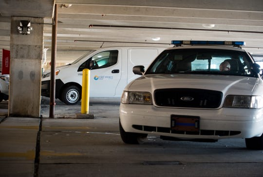 A Fort Pierce Police Department cruiser blocks access to the upper levels at the parking garage near City Hall after a body was discovered there Wednesday, Oct. 2, 2019, in downtown Fort Pierce.