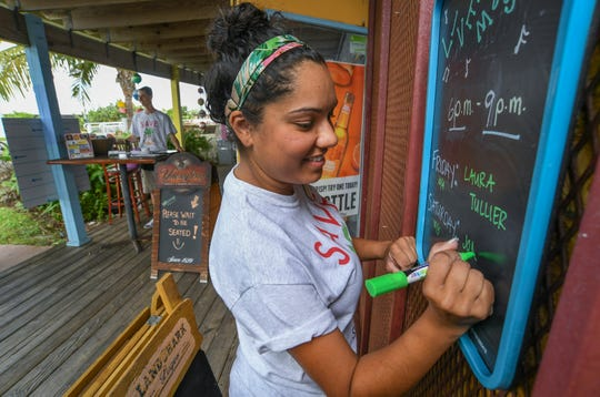 Pelican Cafe manager Chantel Hazell updated the live music entertainers for the upcoming weekend on Wednesday, Oct. 2, 2019, in Stuart.  Located near the southeast corner of the Roosevelt Bridge, the Pelican Cafe overlooks the St. Lucie River, giving its customers a relaxing view of the waterway, just north of Flagler Park in downtown Stuart. The cafe is facing a challenge on extending their short 5-year lease with the city, which expires in October 2021.