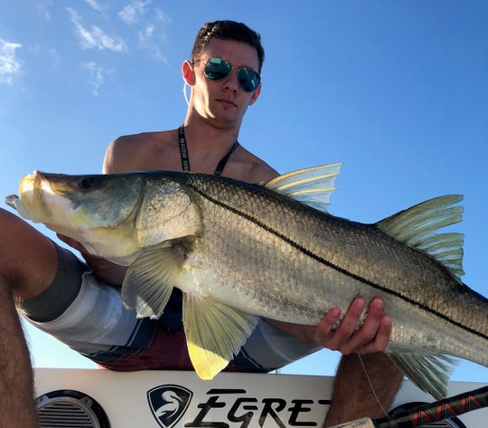 Shane Davison of Stuart, a senior at Martin County High School, caught and released his personal best 42-inch snook Sept. 26 while fishing with a live mullet in the area of The Crossroads.