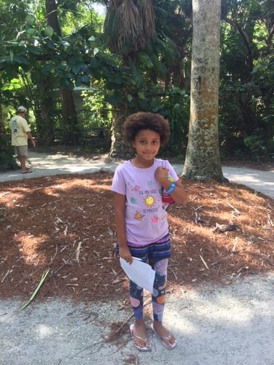 Aziza Gali enjoys exploring McKee Botanical Garden during Community Appreciation Day.