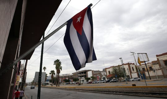 A Cuban flag flies outside the Caribbean Queen Restaurant in downtown Juarez.