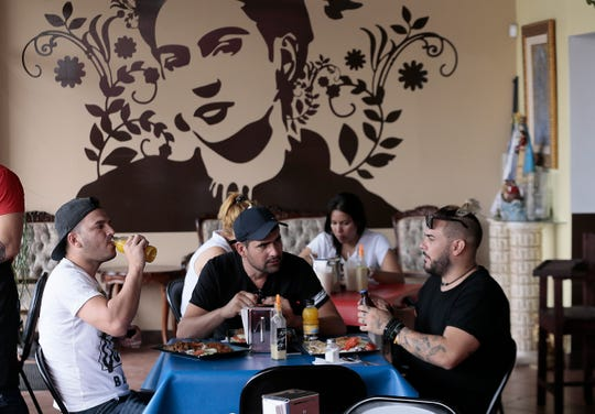 The Caribbean Queen Restaurant in downtown Juarez is run by Cuban asylum seekers. Many of the restaurant's customers are also Cubans awaiting their hearings in the US.