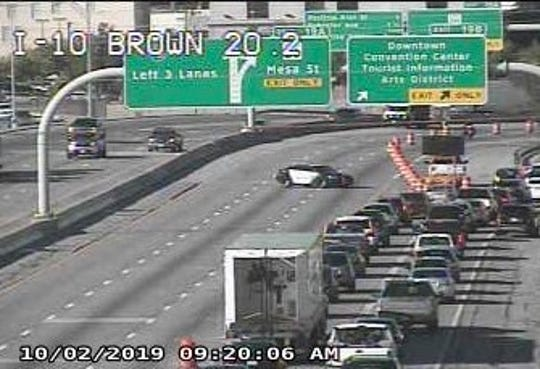 Traffic on Interstate 10 West is directed off the highway at the Downtown exit Wednesday morning in El Paso after a fatal accident closed the roadway.