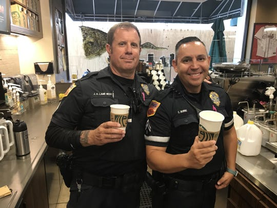Officers Jared Lamb and Charles Burns enjoyed making lattes for customers Wednesday as part of Coffee with a Cop. The campaign continues Wednesday and Thursday morning at the Downtown Starbucks, next to the Plaza Theatre.