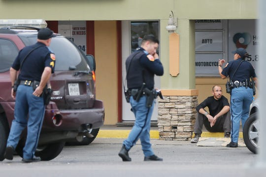El Paso police respond to a call about a suspicious odor coming from a vehicle parked outside 6210 Montana Ave. on Tuesday, Oct. 1, 2019, in El Paso. Public Information Officer Sgt. Robert Gomez said the call came in after 2 p.m. Police do believe something deceased is in the vehicle and are calling it a suspicious death.