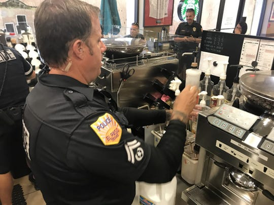 Officer Jared Lamb, of the metro unit Downtown, made lattes as part of Coffee with a Cop campaign at Starbucks Wednesday. They will be back at 9:30 a.m. Thursday and Friday if work doesn't get in the way.