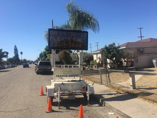 A sign seeking potential witnesses was placed at the site of a fatal traffic collision in October 2019 in Oxnard. The accident killed Alexander Vasquez, 8, who was walking to school.