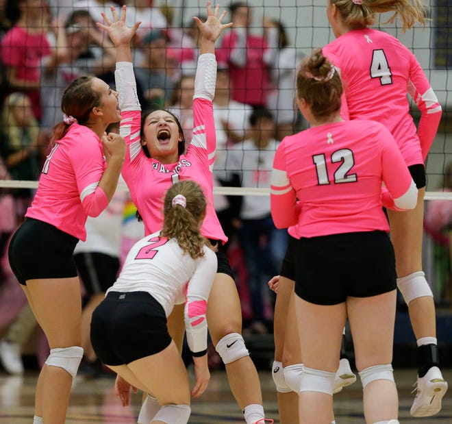 Wausau West 's Cassie Oelke (11) and Robyn Kirsch (1) celebrate after winning a point against Wausau East during a Wisconsin Valley Conference volleyball match on Oct. 1, 2019, at Wausau West High School.