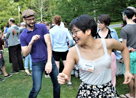 Mike Thibault and Sylvia Chang dance outdoors at Swing Out New Hampshire.