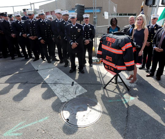 Tara Joyce, widow of Yonkers firefighter Patrick Joyce, speaks during a ceremony renaming New School Street in honor of her husband Oct. 2, 2019. Patrick Joyce died fighting a fire on Waverly Street in Yonkers on Oct. 2, 2009. Members of the fire department, Mayor Mike Spano, and other members of city government, along with the Joyce family, were on hand for the ceremony.