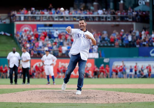 Former Texas Rangers player Michael Young throws out the final ceremonial pitch during a postgame ceremony at Globe Life Park following a contest between the New York Yankees and the Rangers in Arlington, Texas, Sunday, Sept. 29, 2019. The Rangers will begin playing at Globe Life Field, across the street, in the 2020 season. (AP Photo/Tony Gutierrez)
