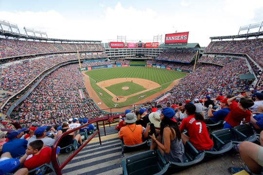 The Texas Rangers play the New York Yankees in the fifth inning of a baseball game at Globe Life Park in Arlington, Texas, Sunday, Sept. 29, 2019. (AP Photo/Tony Gutierrez)