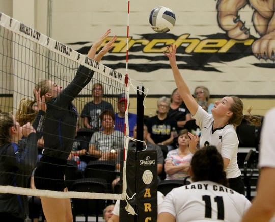 Archer City's Maggie Coates hits the ball by Windthorst's Kora Pennartz Tuesday, Oct. 1, 2019, in Archer City. The Trojanettes mounted a comeback to defeat the Lady Cats 3-2 (16-25, 12-24, 25-18, 26-24, 15-12).